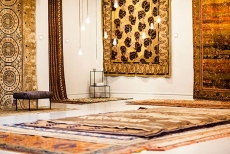 An assemblage of swoonworthy rugs from around the world is displayed, gallery-style, in New York's ABC Carpet & Home.