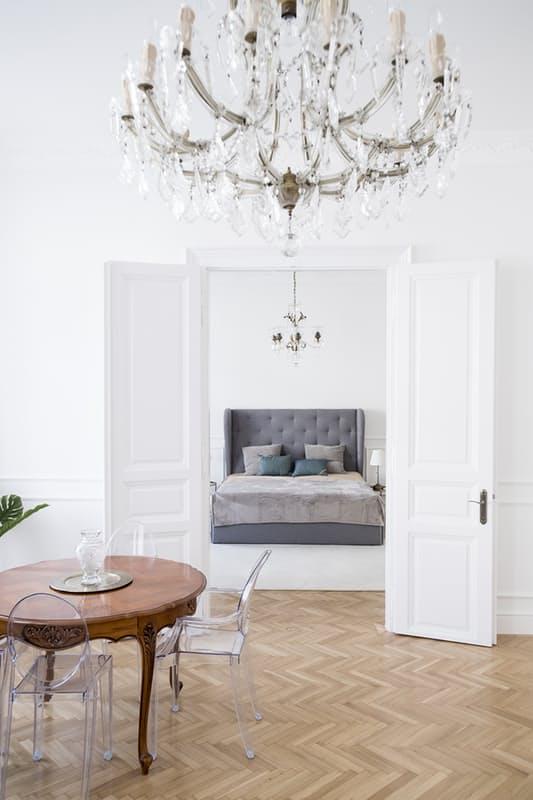 Parisian French interior decor white elegant bedroom living room chandelier