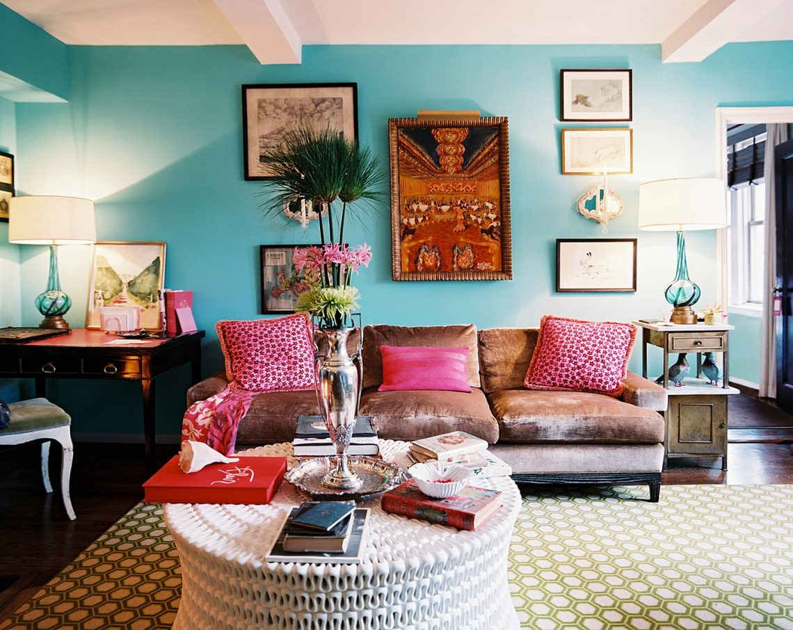 boho-chic-bohemian-style-living-room-blue-wall-color-ethnic-abstract-painting-honeycomb-carpet-pattern-white-table-hardwood-fur-sofa-table-single-chair