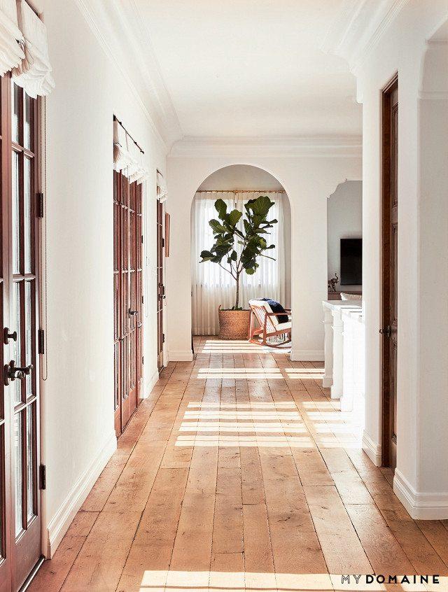 lauren conrad interior decor,white hallway, wooden floor, white interior, elegant interior decor