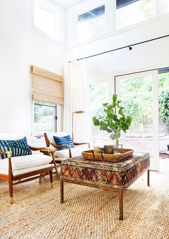 california cool decor, boho interior, vintage rug, peacock chair