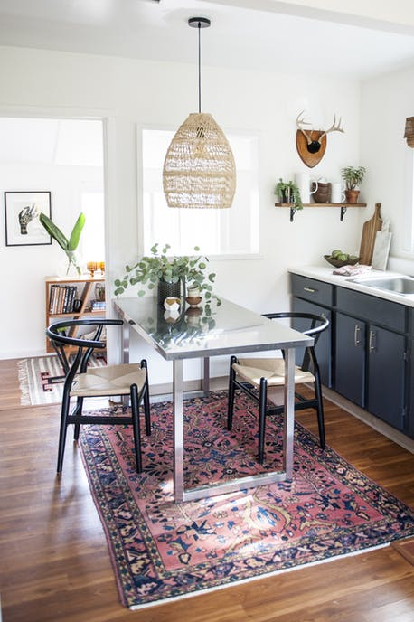 statement rugs, oriental antique rug in dining room